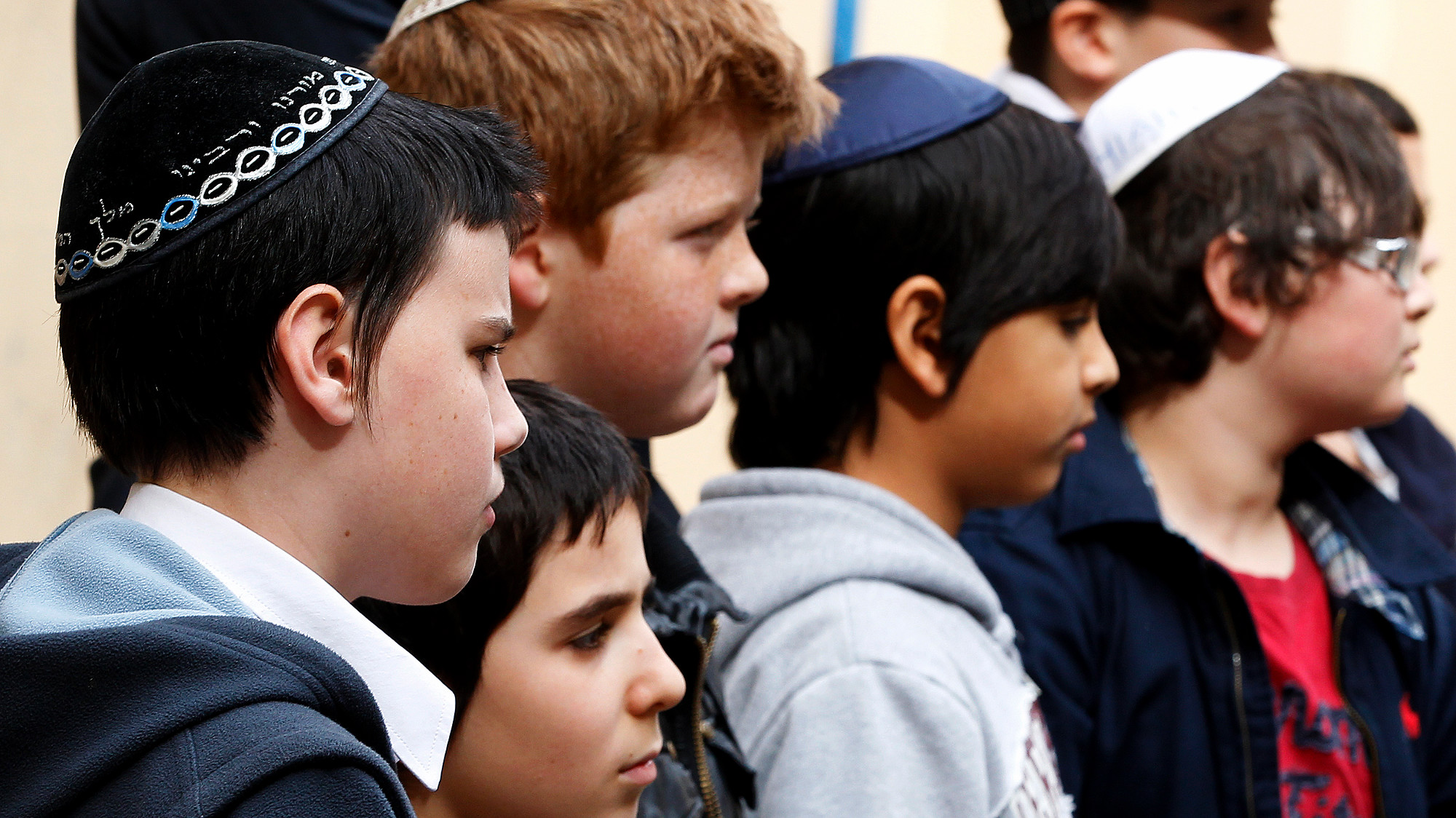 School children attend a religious ceremony and observe a minute of silence at the Jewish school Kerem Menahen in Nice